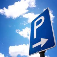 parking sign (4) with blue sky and clouds